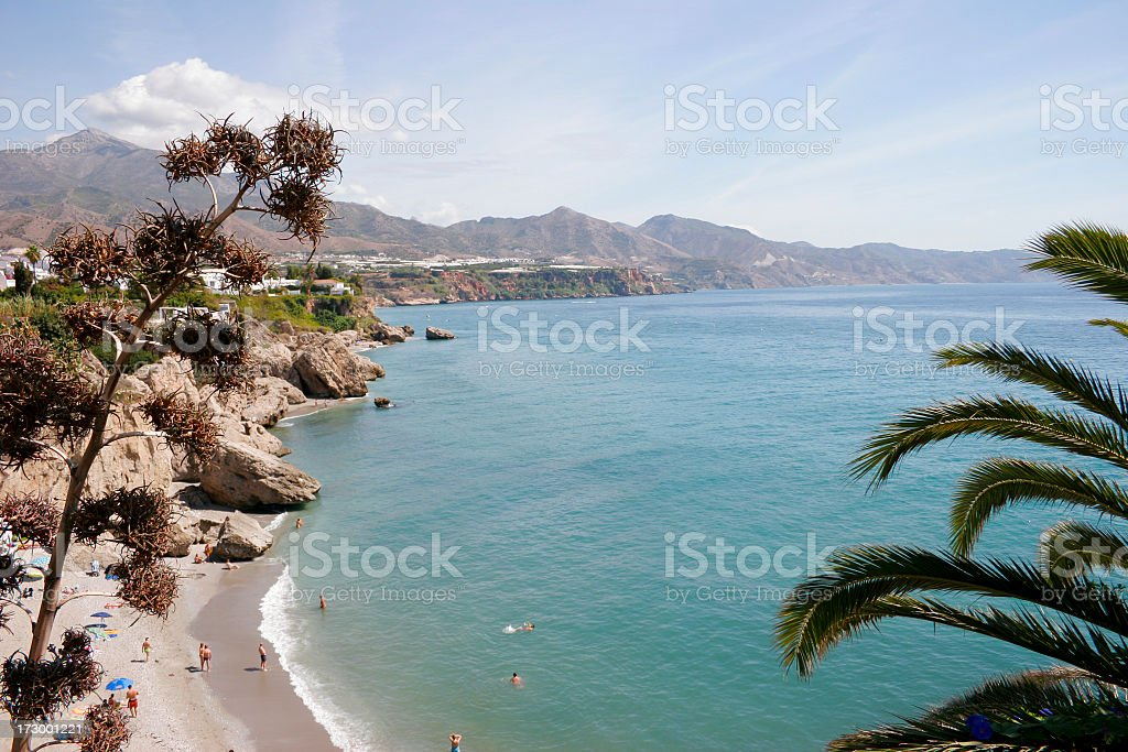 View from above cliffs by the Mediterrean coast & mountains stock photo