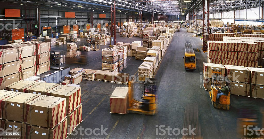 View from above inside a busy huge industrial warehouse stock photo