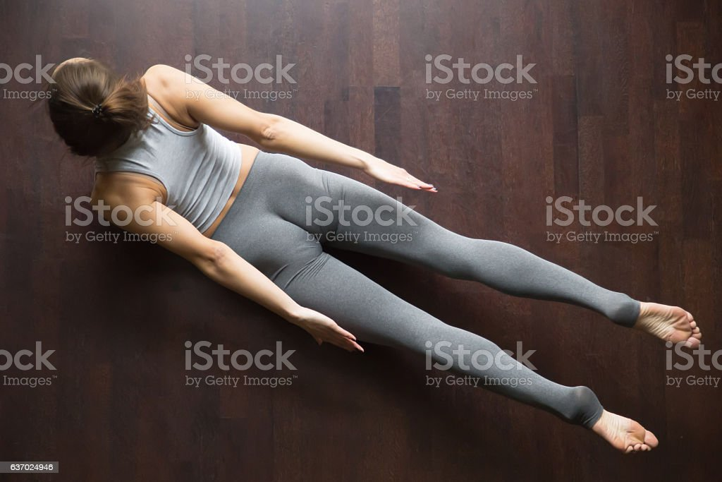 View from above of Salabhasana yoga Pose stock photo