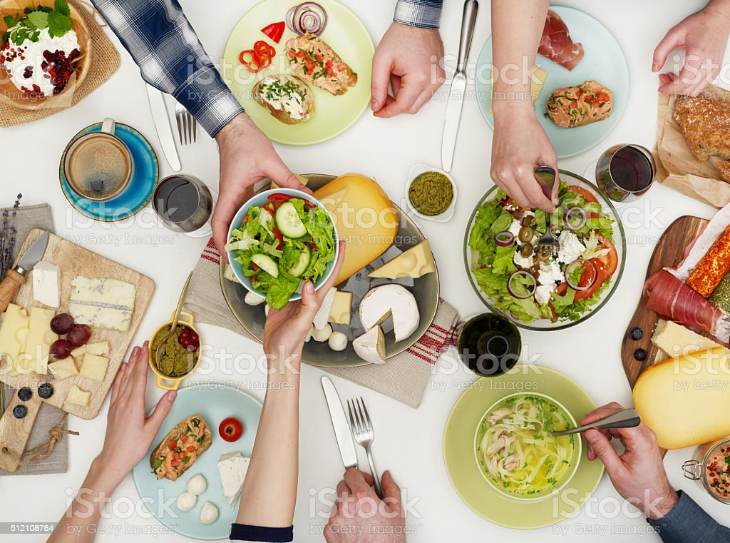View from above the table of people eating stock photo