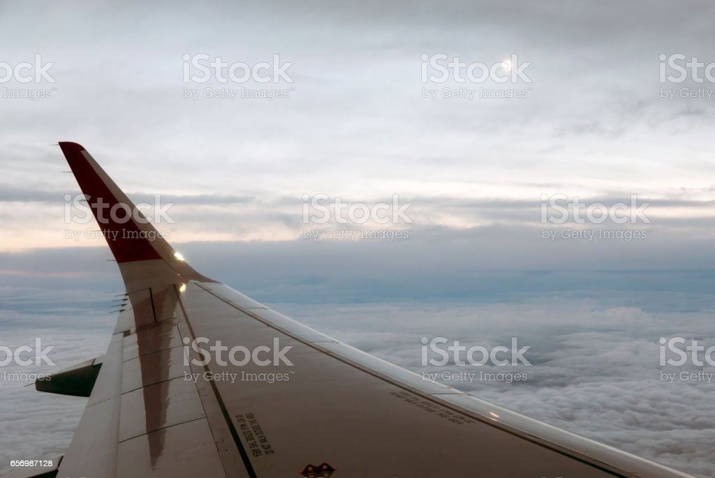 View from airplane window. Flying over the white clouds stock photo