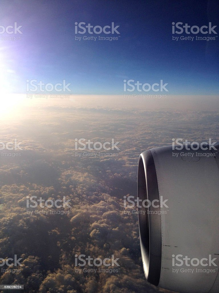View from airplane window to airscrew during sunrise stock photo