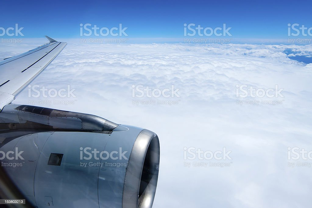 view from an airplane flying in the clouds royalty-free stock photo