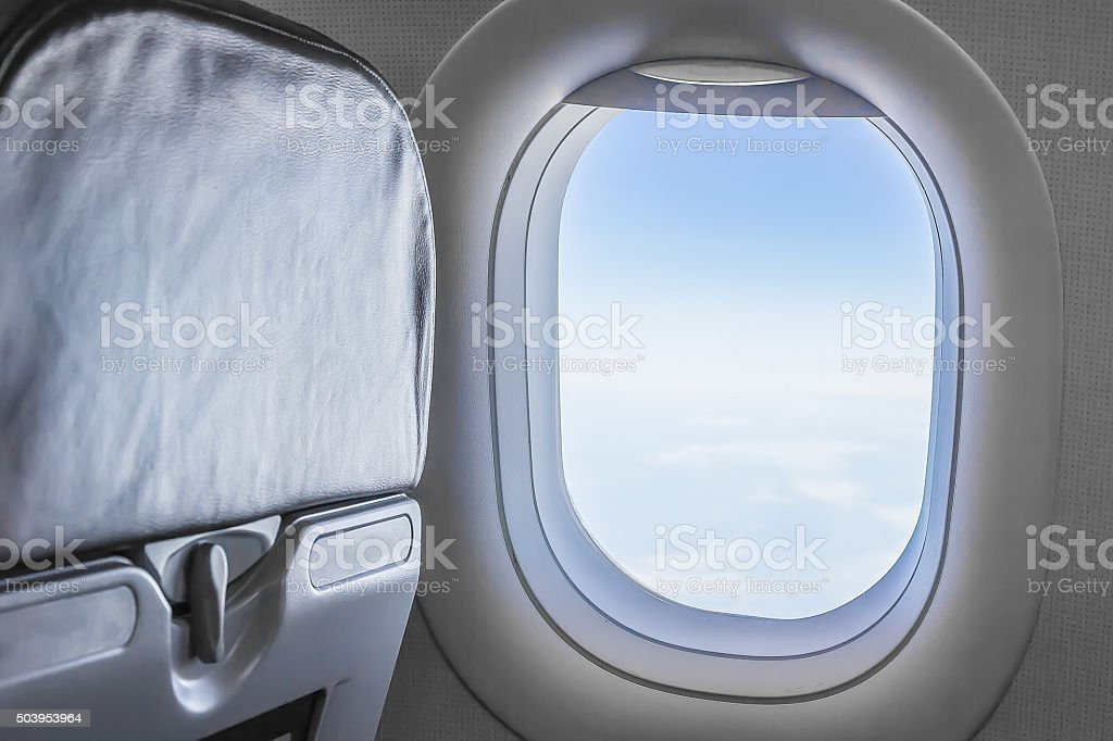 view from an airplane window at the sky stock photo
