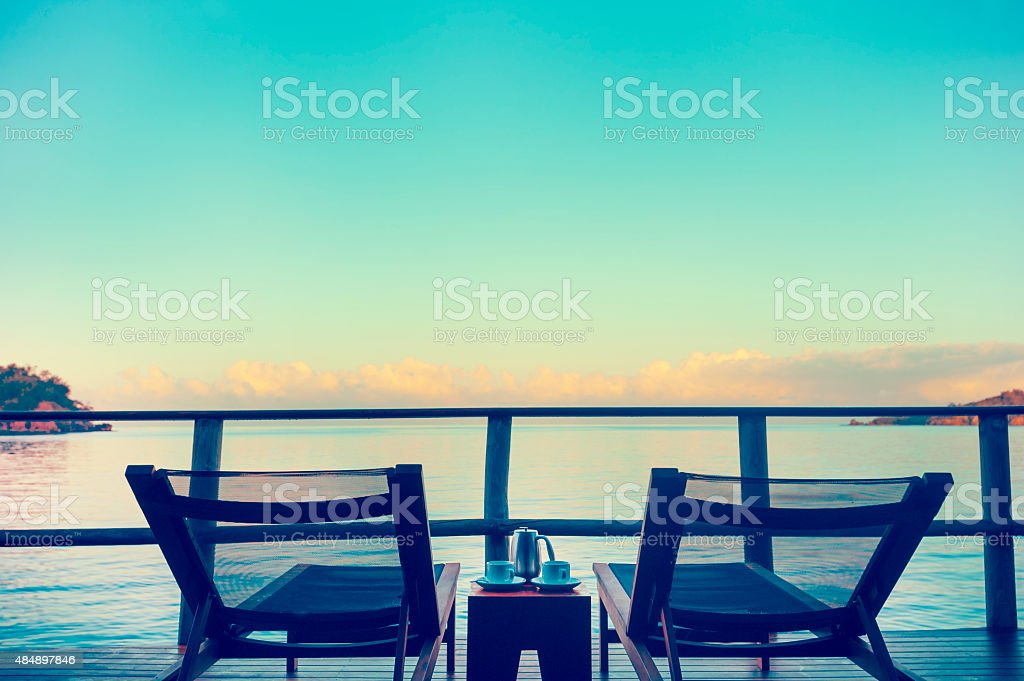 View from an over water bungalow with sun lounges. stock photo