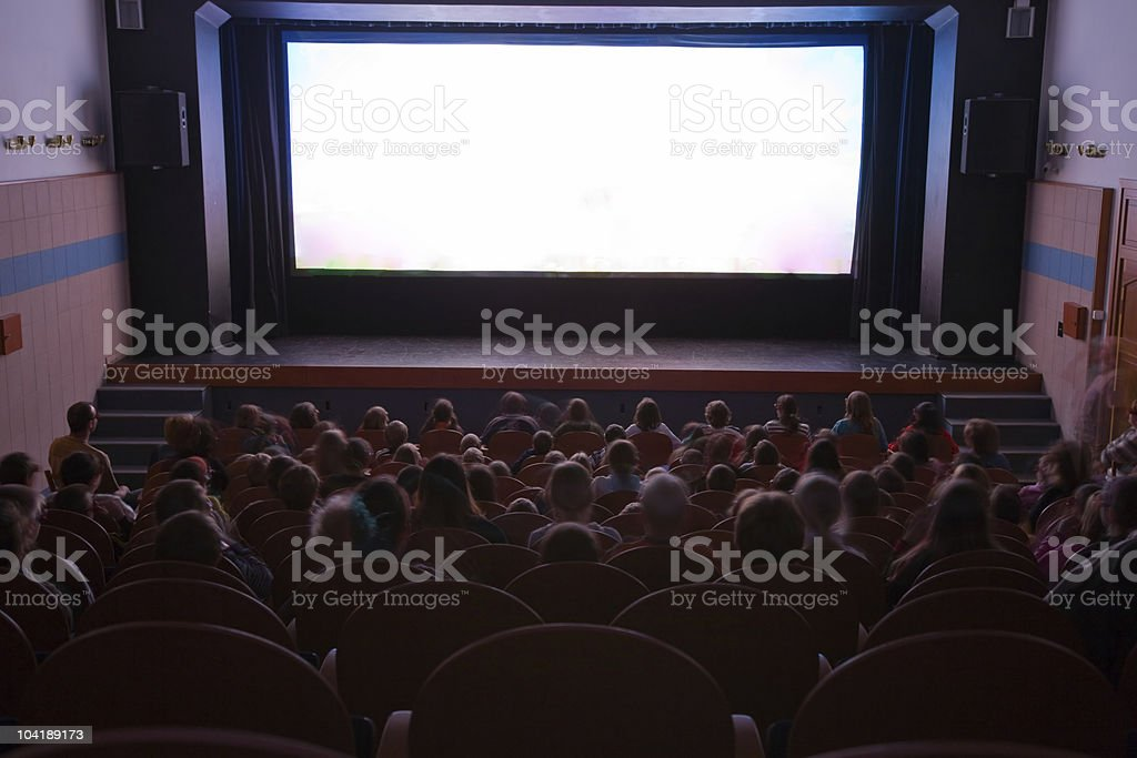 View from back of a crowded movie theater stock photo