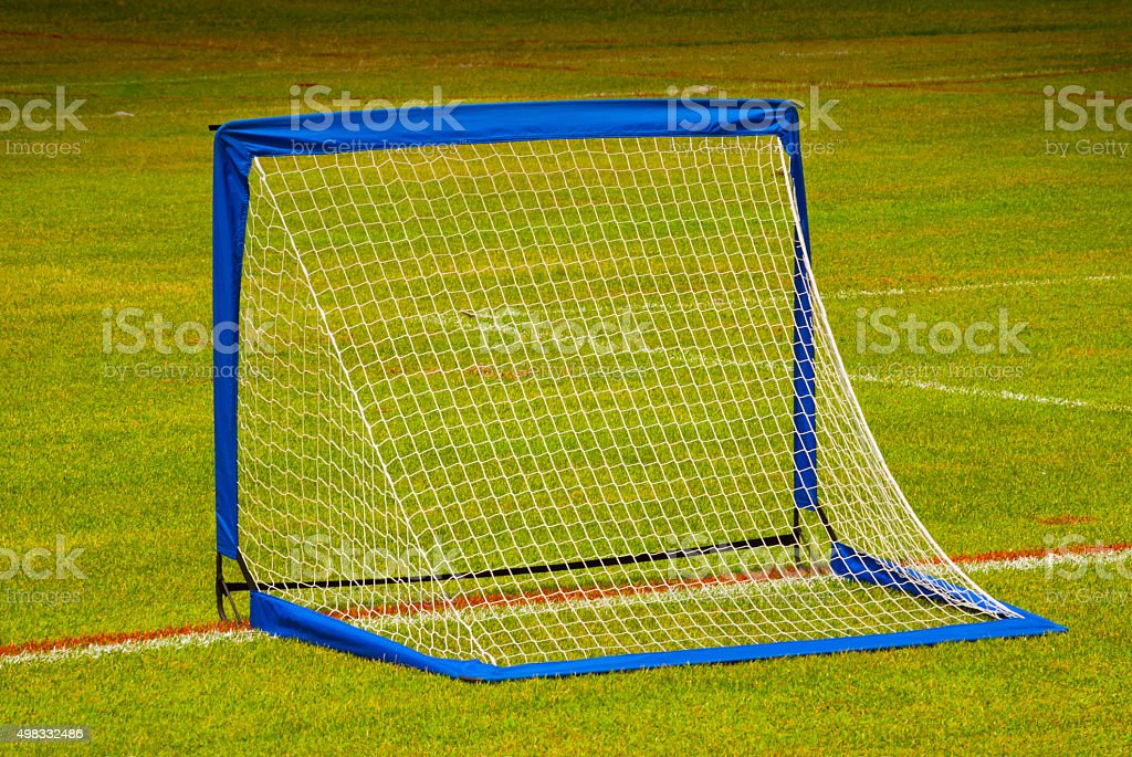 view from behind the net on a soccer pitch. stock photo