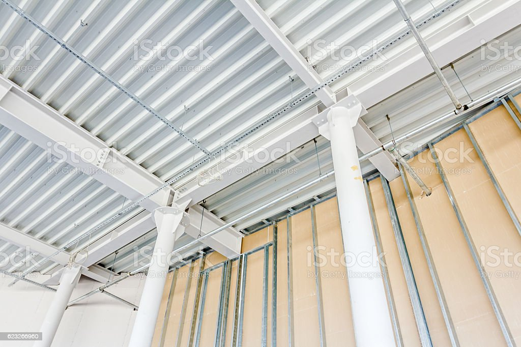 View from below on painted pillar with steel joints stock photo
