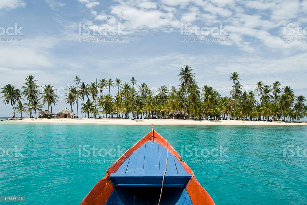 View from boat over cove and the sandy beach of Kuna Ayala stock photo