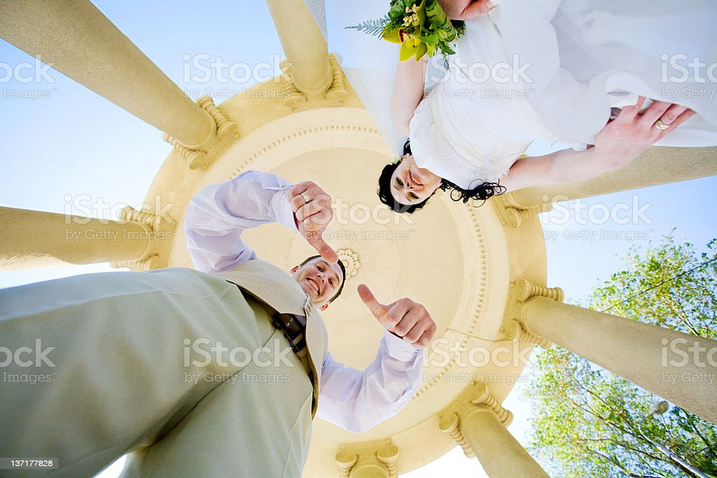 view from bottom to bride and groom royalty-free stock photo