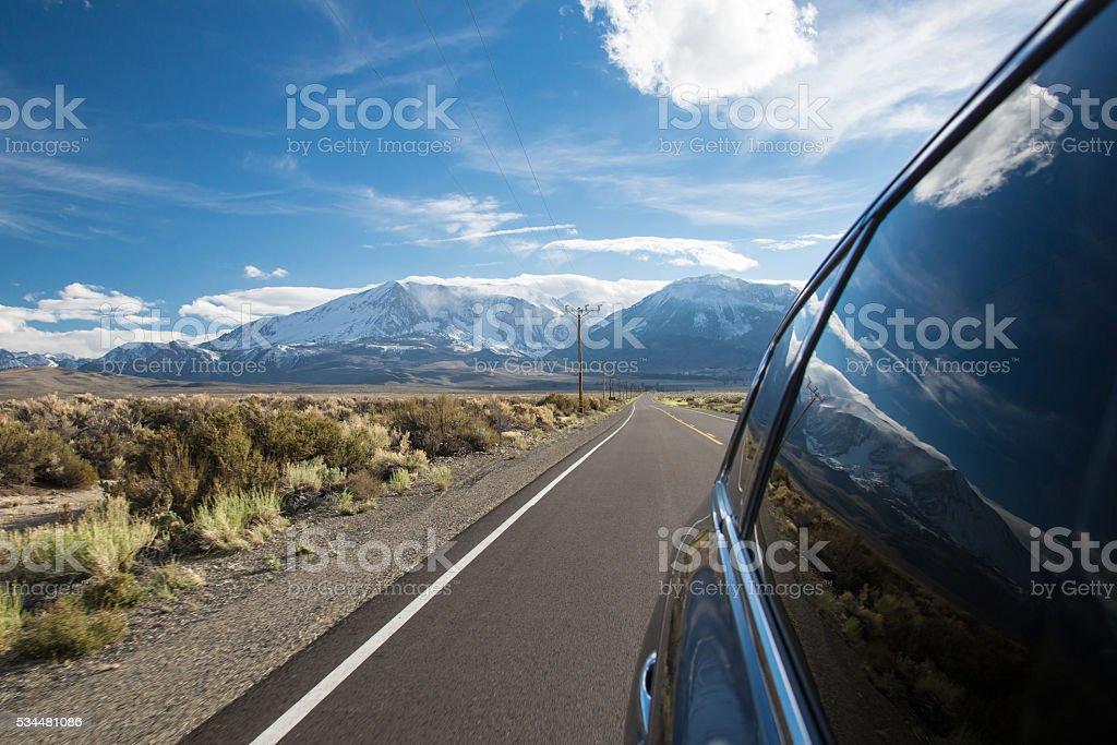 view from car window to the mountains of Sierra Nevada stock photo