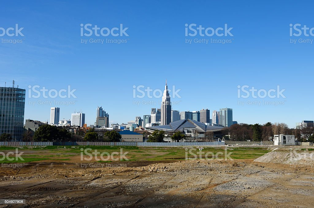View from construction sites against skyscrapers and clear sky stock photo
