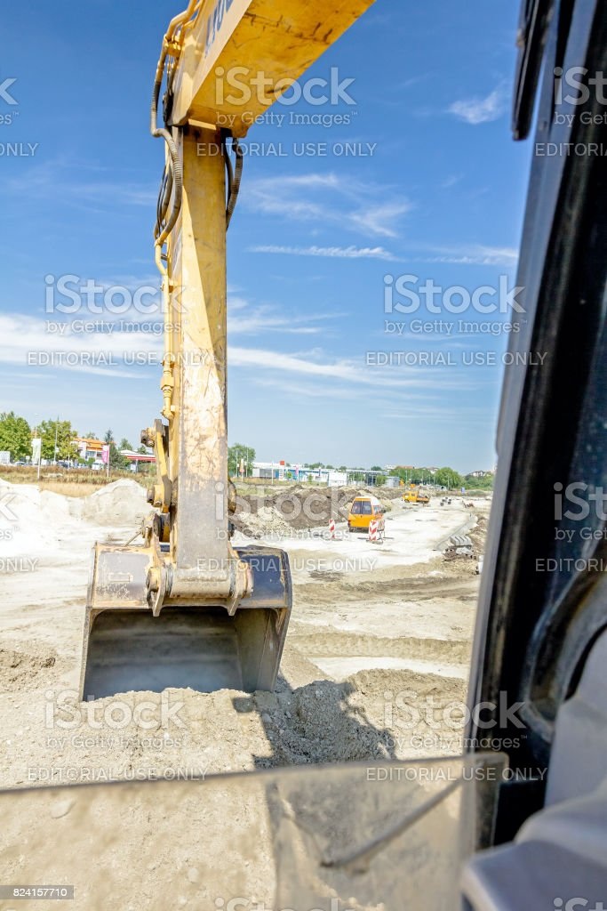 View from excavator's cabin on work tool, bucket, blade stock photo