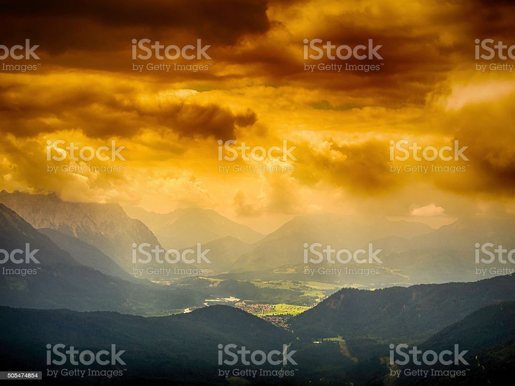 View from Herzogstand to dark storm clouds stock photo