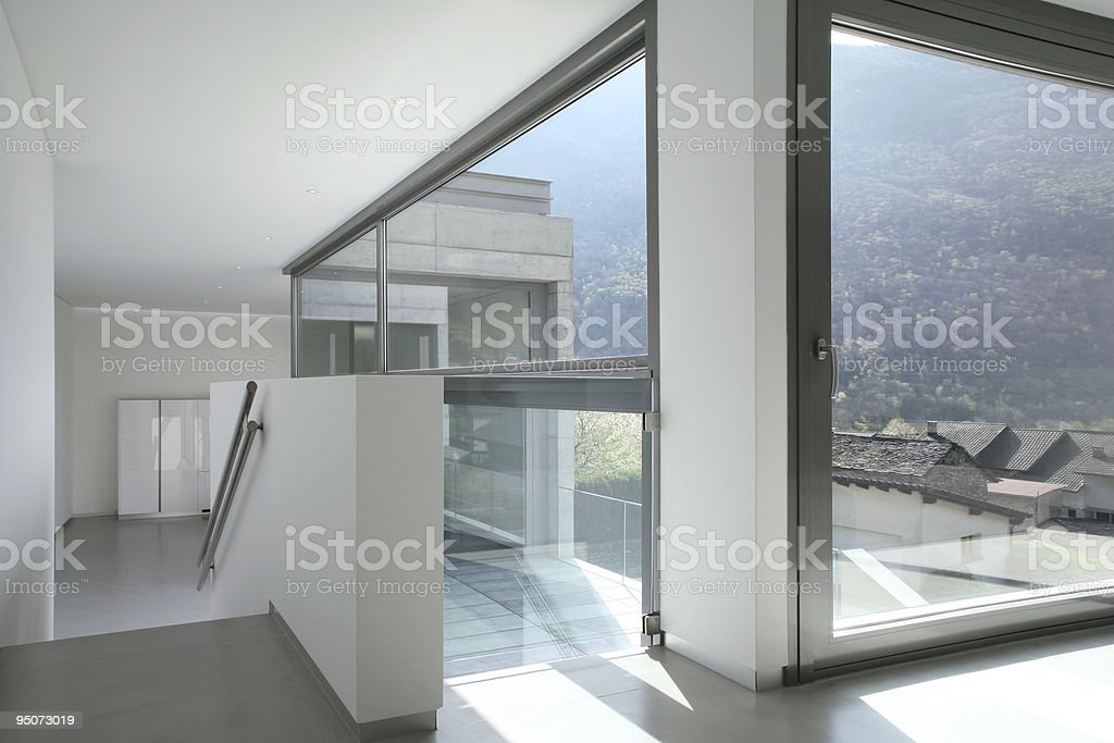 View from inside of a modern house looking over landscape royalty-free stock photo