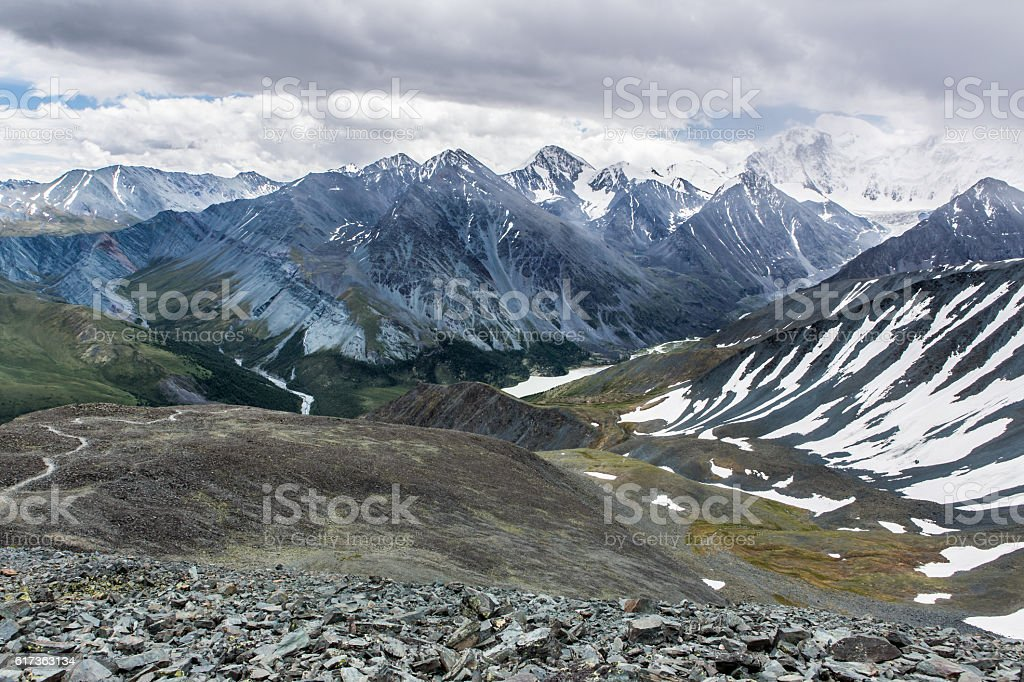 View from Karaturek mountain pass to Beluha mountain in cloudy weather stock photo