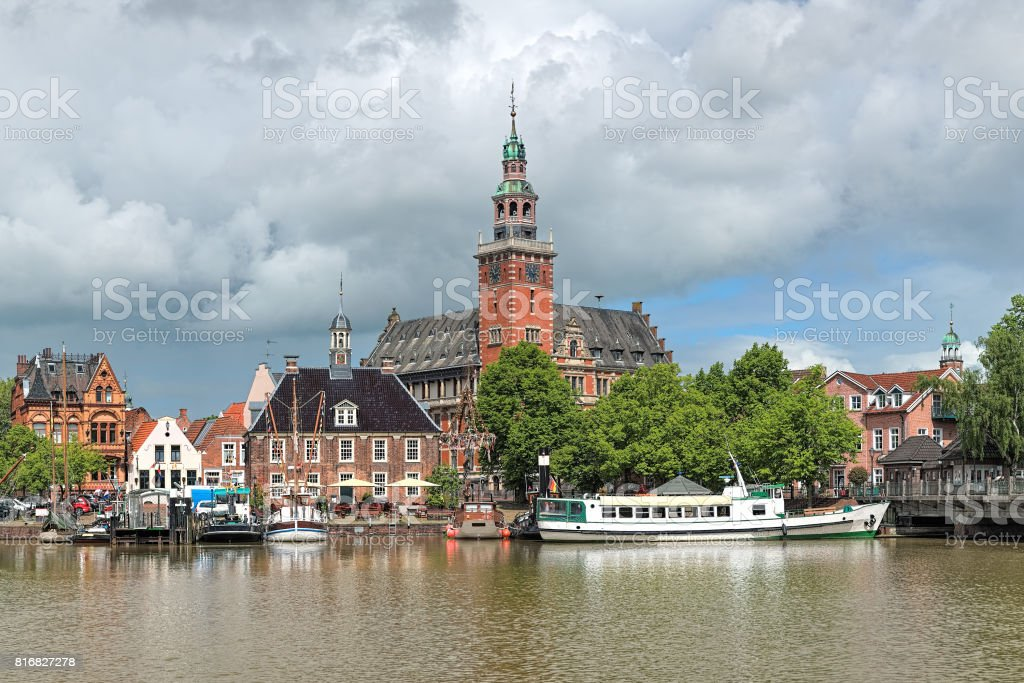 View from Leda river on City Hall and Old Weigh House in Leer, Germany stock photo