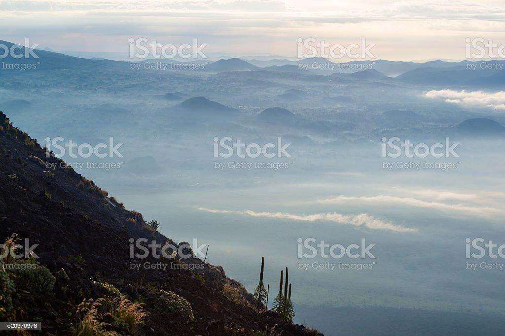 View from Mount Nyiragongo (3.470 m) to Rwanda stock photo