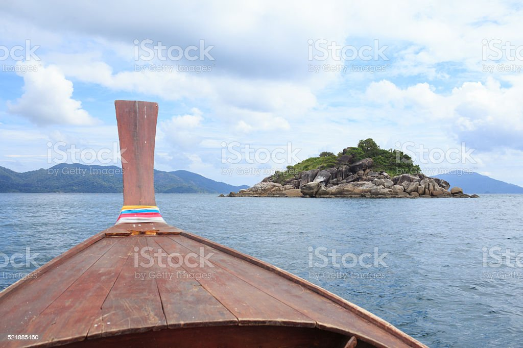 view from nose of long tail boat in a sea stock photo