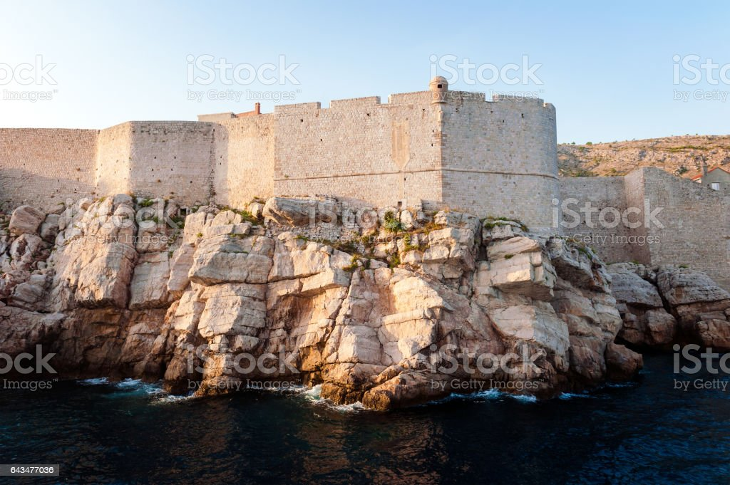 View from open sea to defensive city walls of Dubrovnik stock photo