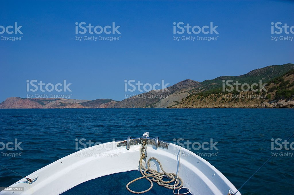 View from sailing boat rostrum to sea coast royalty-free stock photo