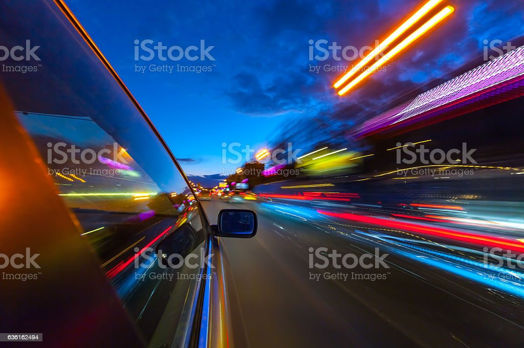 View from Side of Car moving in a night city. stock photo