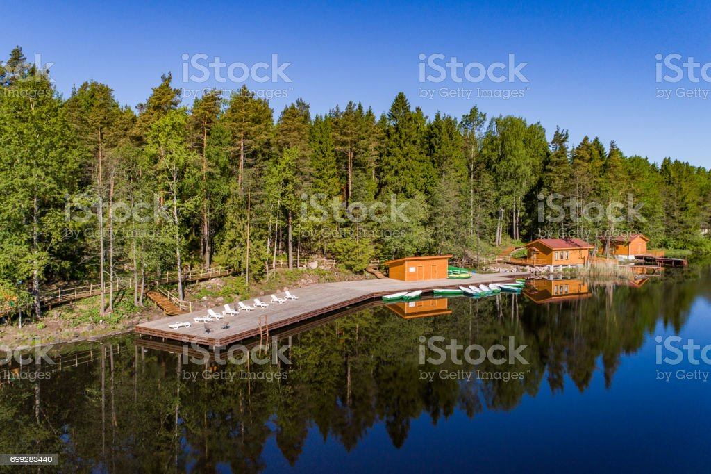 View from the air to the shore of the lake with a boat station stock photo