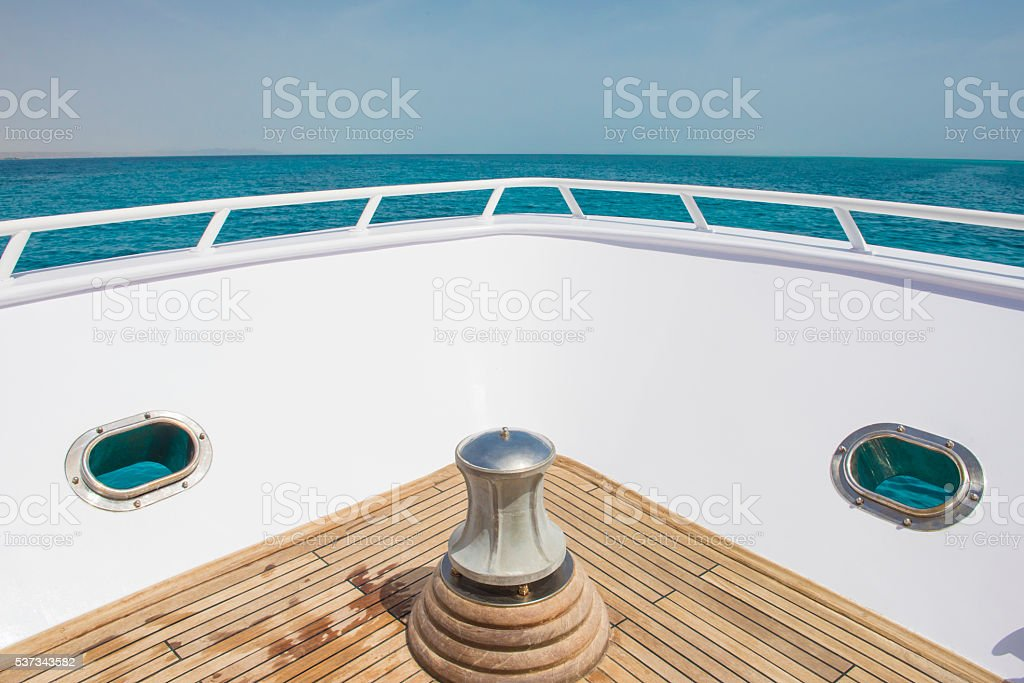 View from the bow of a boat over tropical ocean stock photo