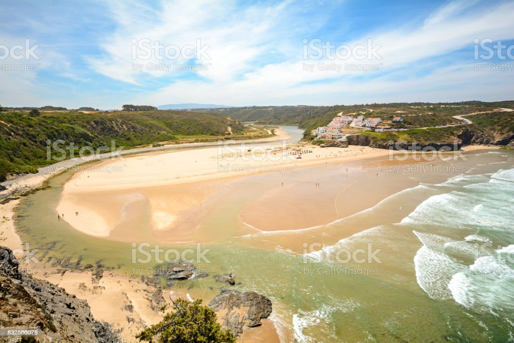 View from the cliffs to surfer beach Praia de Odeceixe, District Aljezur - Algarve Portugal stock photo