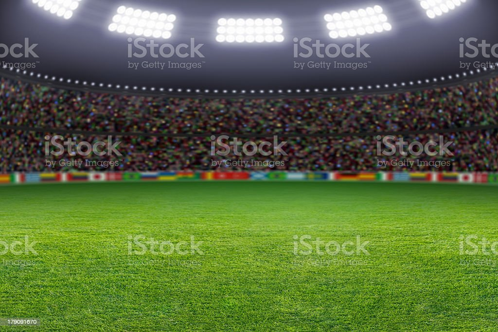 A view from the grass up of a soccer stadium royalty-free stock photo
