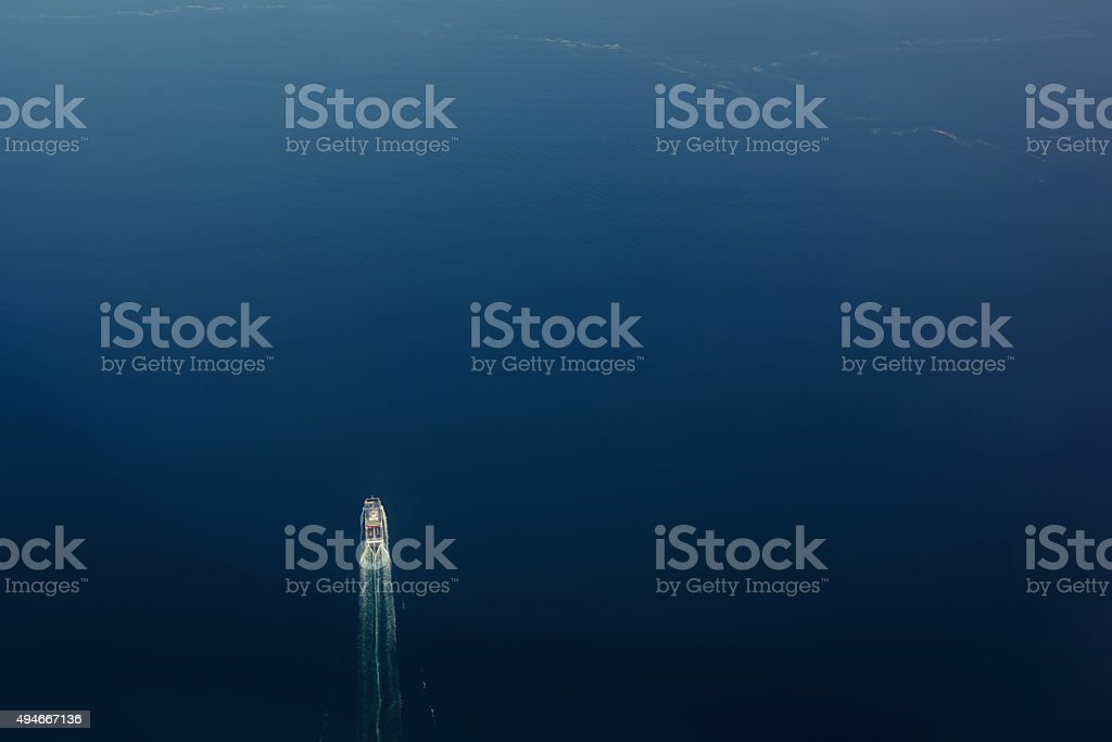 View from the plane on a large yacht at sea stock photo