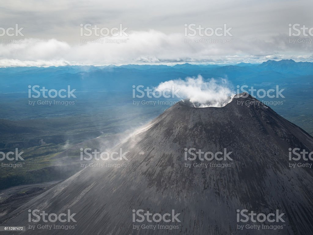 View from the plane on volcano Karymskii with active crater stock photo