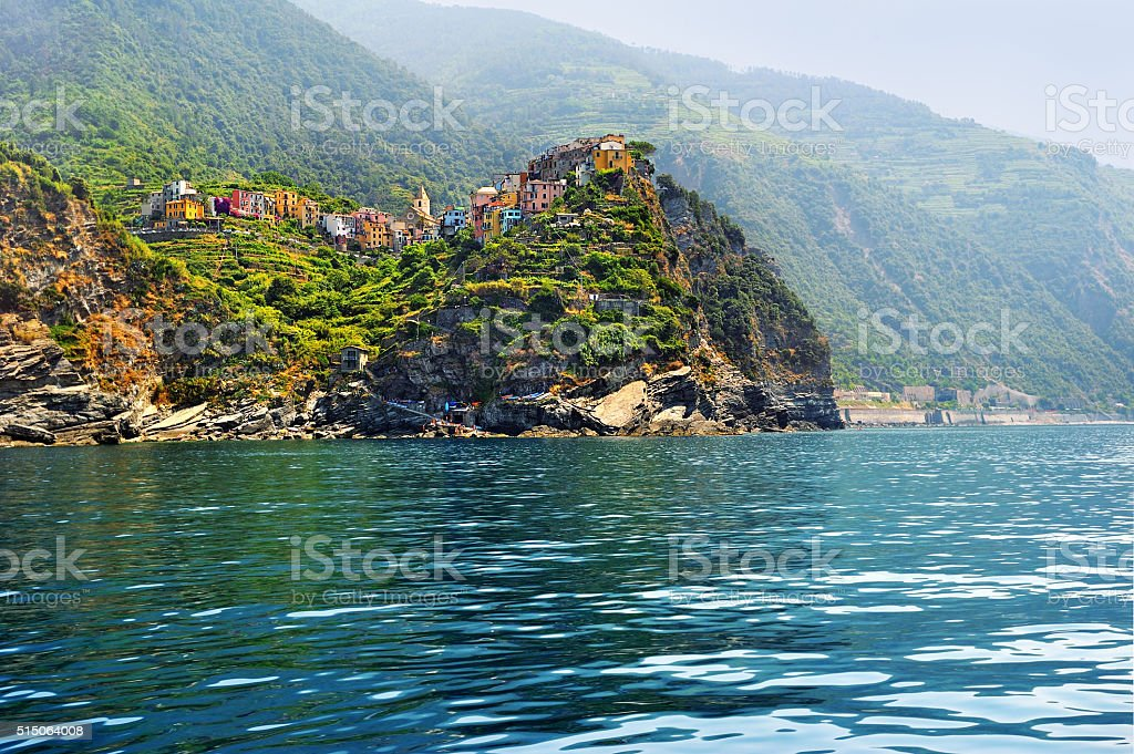 View from the Sea on village Corniglia with terraced vineyards stock photo