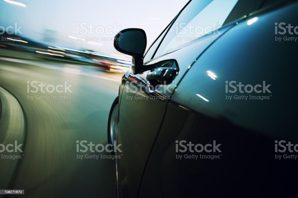 View from the side of a car going around a corner blurred stock photo