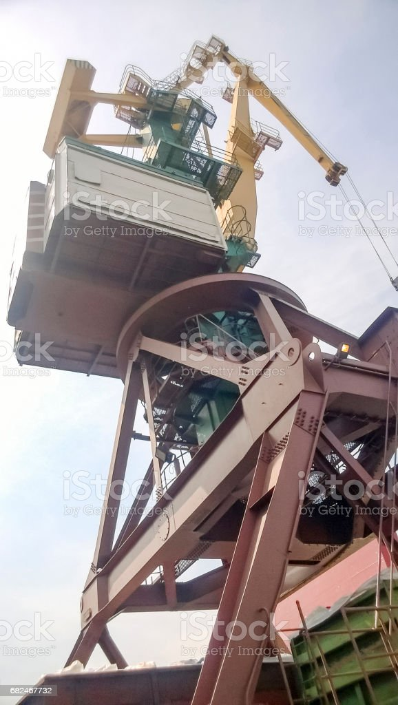 View from the top to the top of the port tower crane. Industrial port stock photo