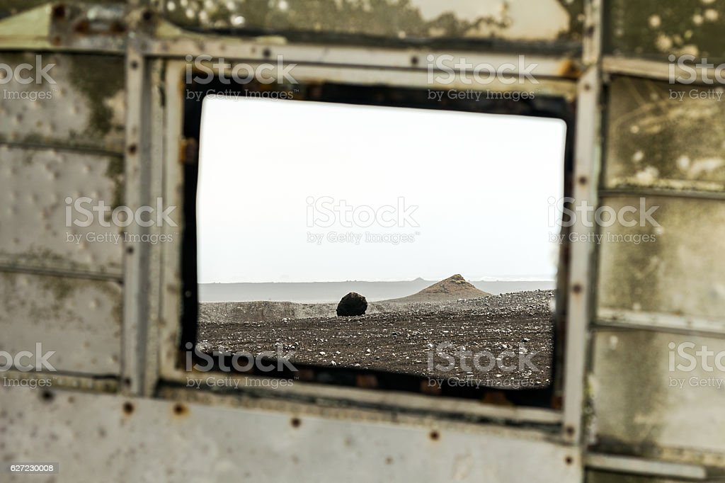 View from the window, inside the old airplane wreck, Iceland stock photo