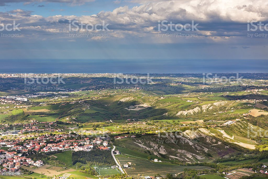 View from Titano mountain at Italian neighborhood and the sea royalty-free stock photo