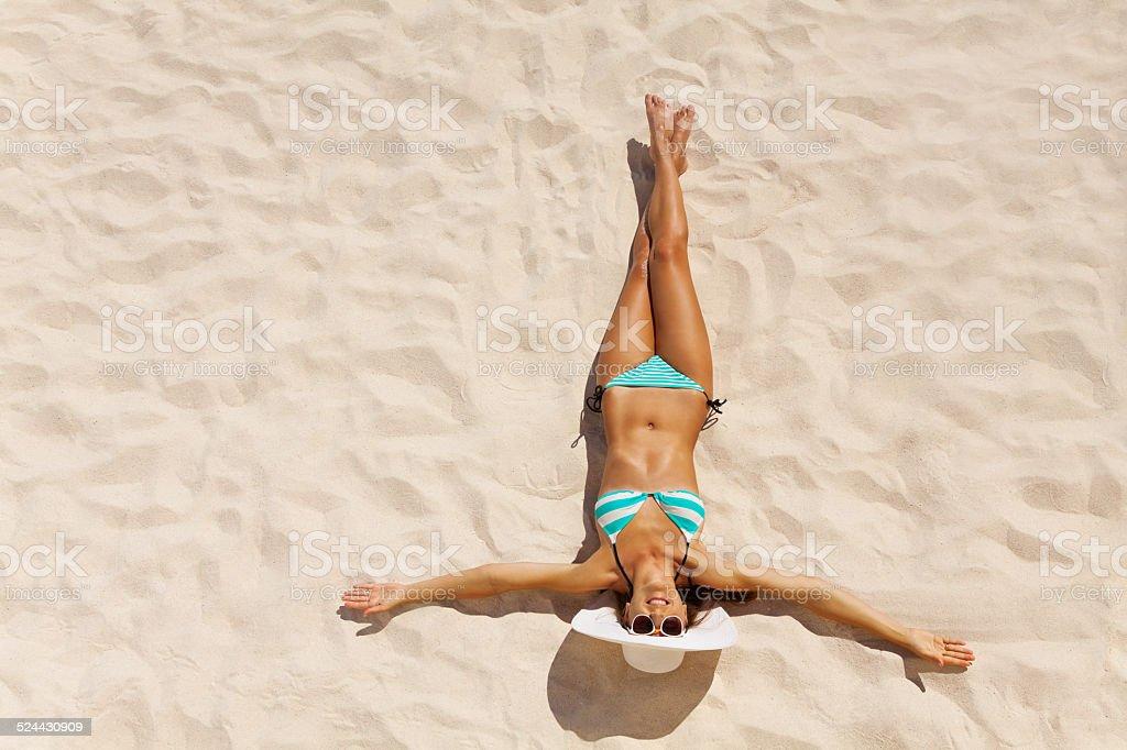 View from top of girl in bikini wearing white hat stock photo