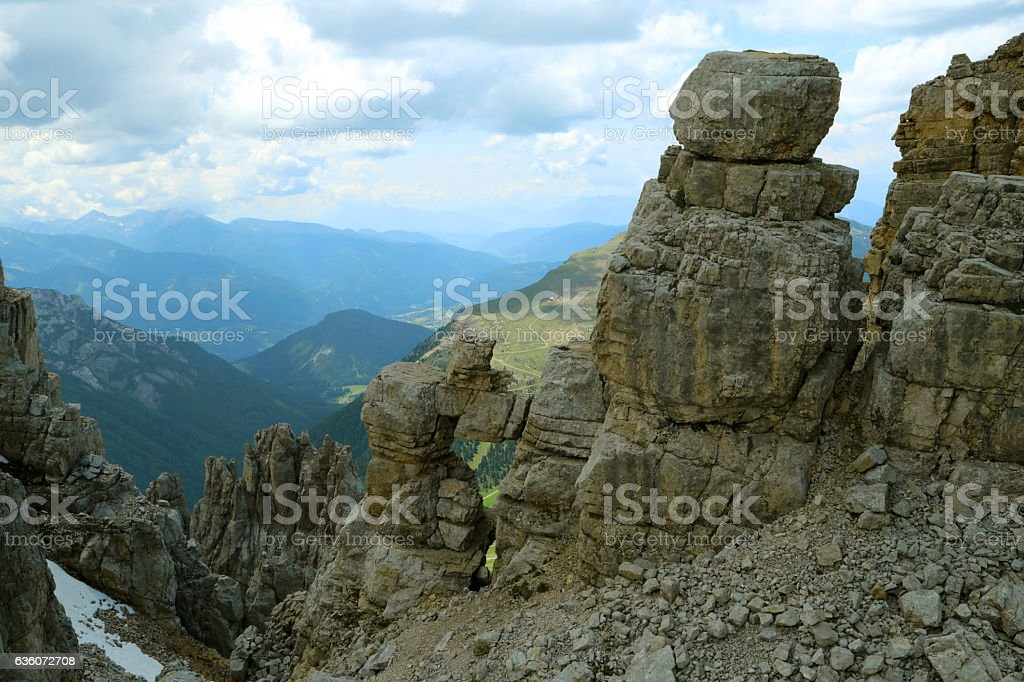 View from top of Latemar mountain and a natural window stock photo