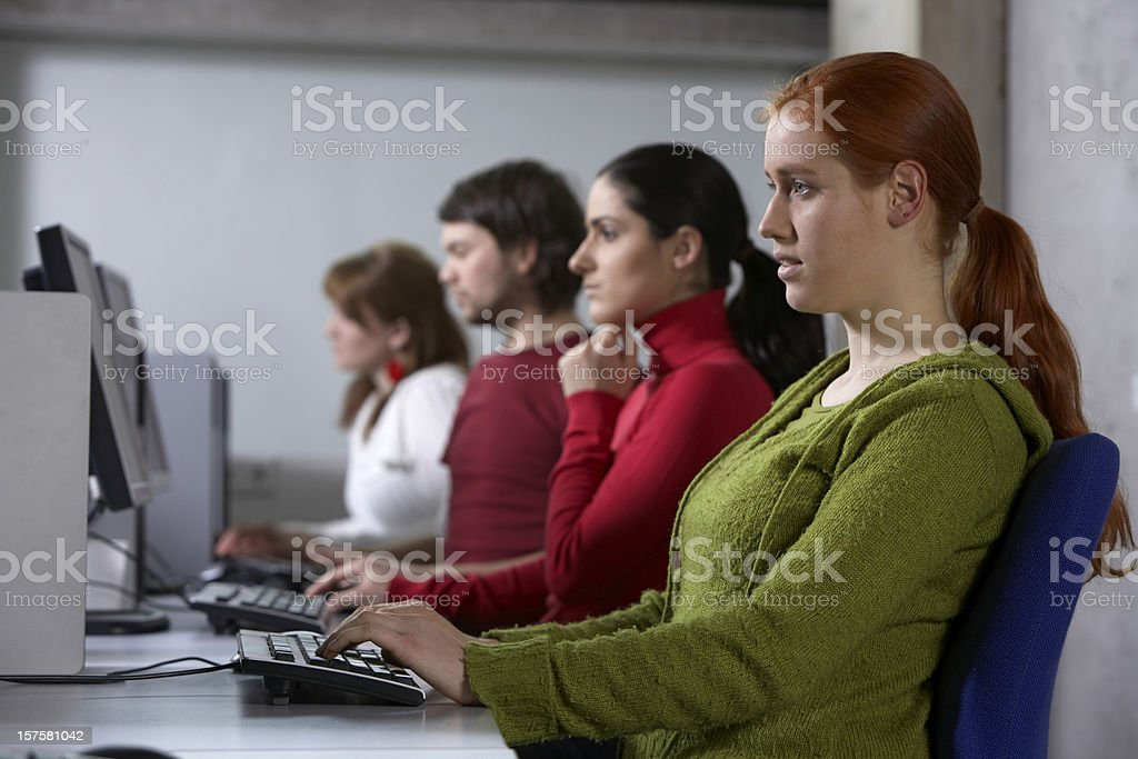 View into a callcenter row of business persons royalty-free stock photo