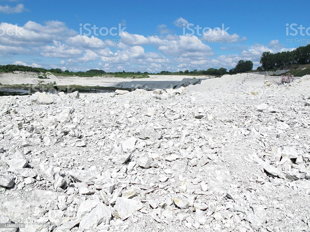 view into a chalk rock open pit mine stock photo