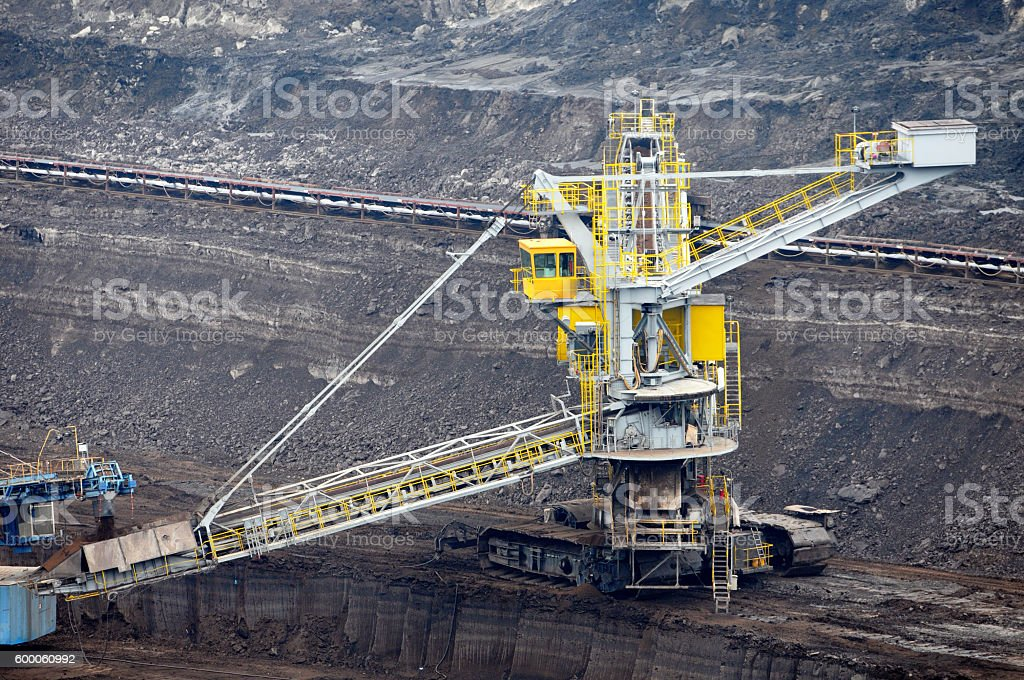 view into a coal mine with bucket wheel digger stock photo