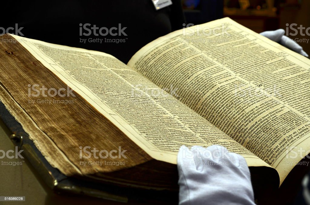 view into a very old and thick book, bible stock photo