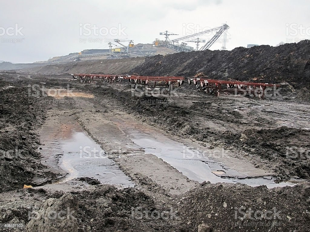 view into coal mine with machines and conveyor belt stock photo
