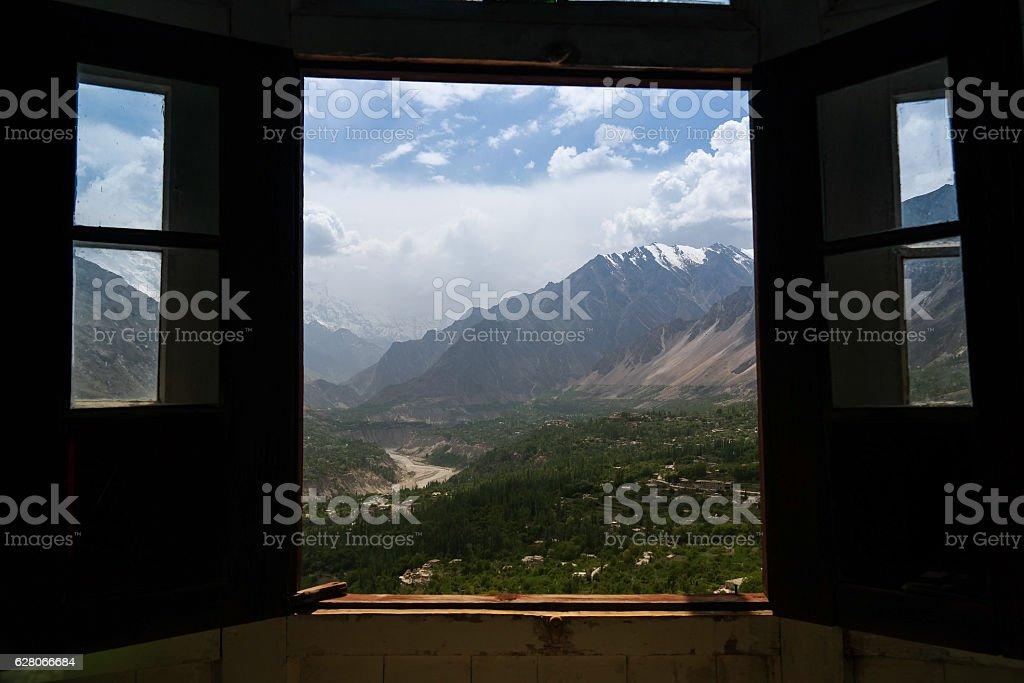 View Karimabad Hunza valley through the Baltit fort window, Pakistan stock photo