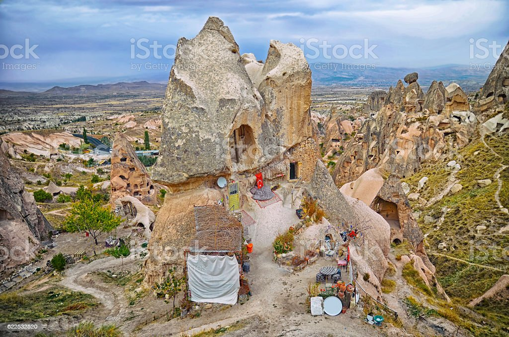 View landscape with ancient rock carved houses in Nevsehir stock photo
