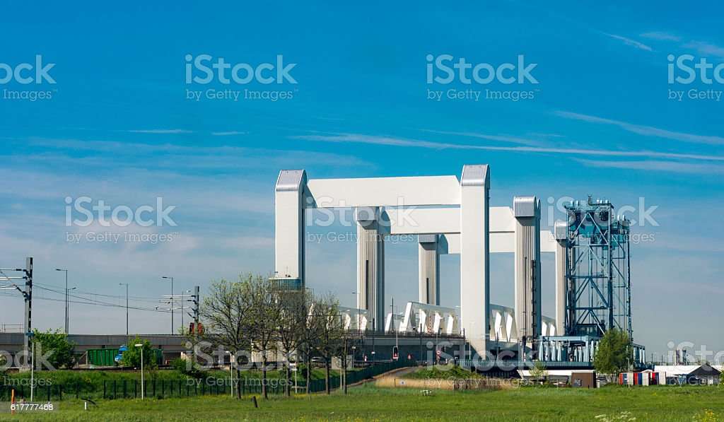 View left new  and  right old botlek lifting bridge stock photo