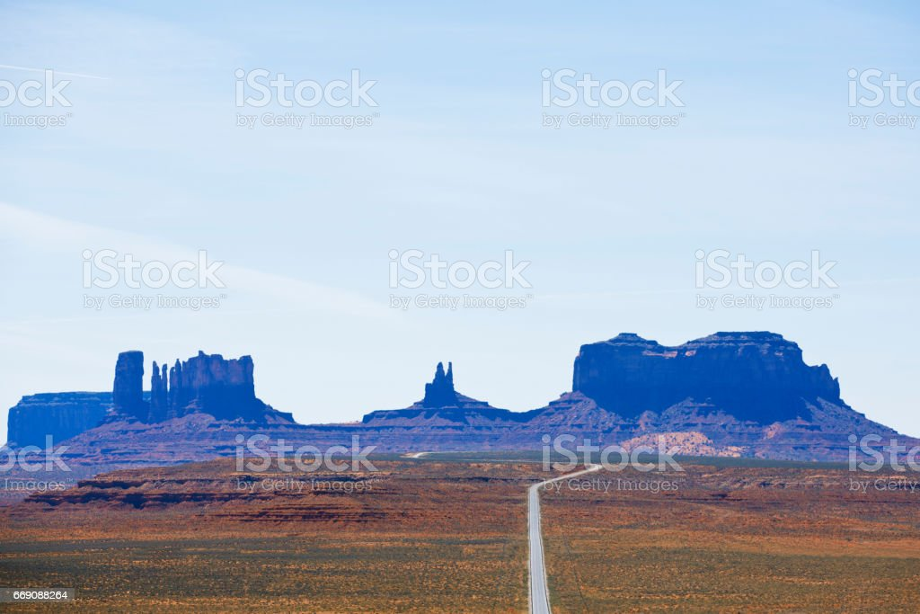 A view looking south at Highway 163 and Monument Valley in Utah, USA. stock photo