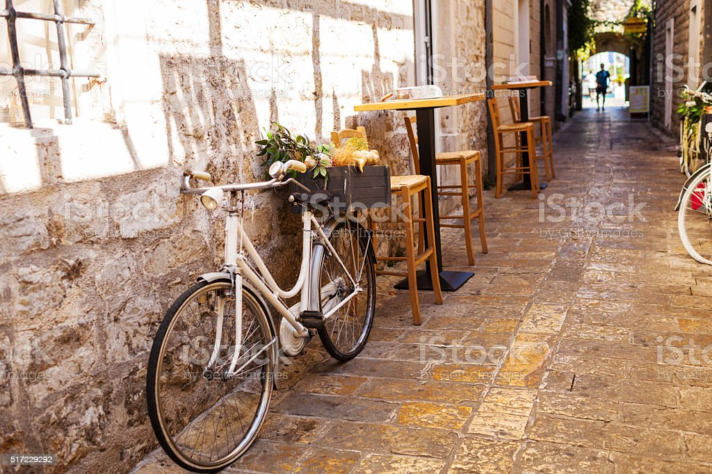 view narrow street in old district of Budva, Montenegro stock photo