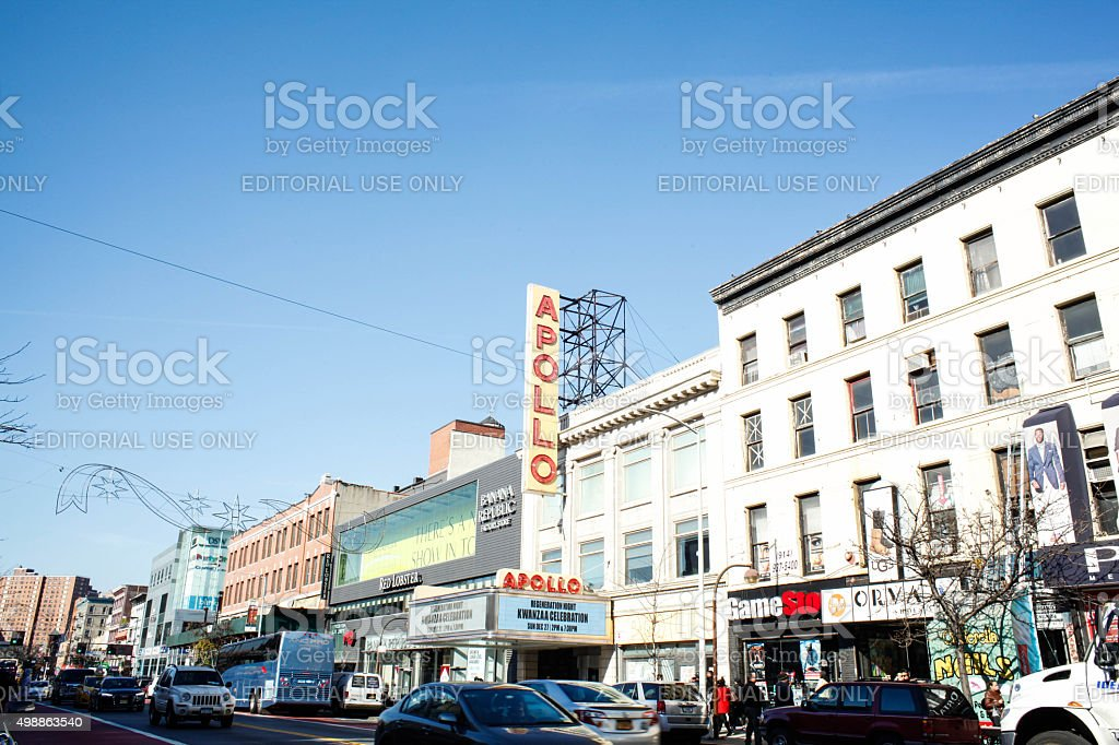 View of 125th street retail strip, Apollo theater in Harlem. stock photo